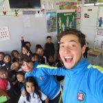 Danny with children in Ecuador