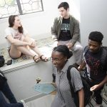 students in stairwell of dorm