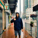 David Song in rain in Hong Kong