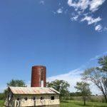 empty silo with blue sky