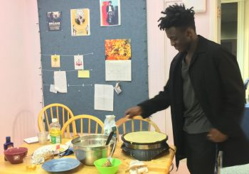 student making crepes