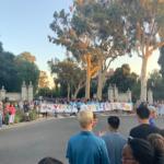 Students running through Pomona's gates