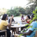 students eating on Frank patio