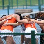 Tennis players in huddle