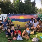 Siena and her sponsor group after painting Walker Wall
