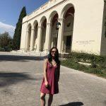 Deanna standing in front of Bridges Auditorium