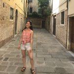 Deanna Han in courtyard between buildings
