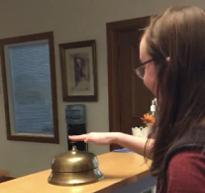 student ringing desk bell