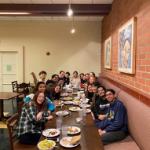 Sophia's sponsor group eating dinner together