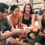 students having cupcakes at the beach