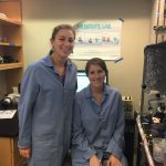 Libby and friend in lab coats