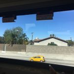 view of car on freeway outside train window