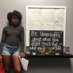 Magali in front of sign about being yourself