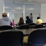 CS class looking at white board