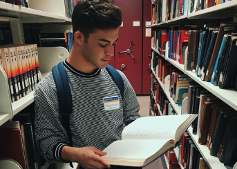 Darien with book in library
