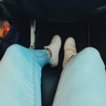 looking down at feet while seated on plane