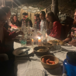 students having dinner at a professor's house