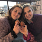 Nelia and her sister with donuts