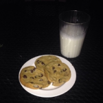 plate of chocolate chip cookies with glass of milk