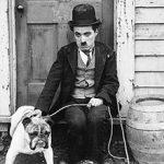Charlie Chaplin with a dog