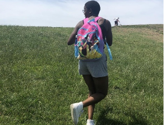 Oluyemisi with a Princess backpack