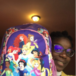 Oluyemisi holding up Princess Pack 2