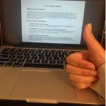 laptop shows a guide to writing cover letters