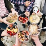 people holding smoothie bowls