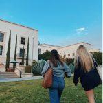 students walking toward Honnold Library