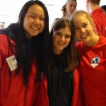 Nelia with 2 other orientation leaders, all in red