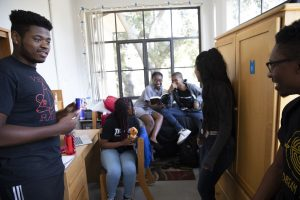 a group of students hanging out in dorm room