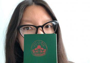 Sonam holding her Green Book