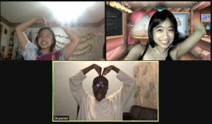 Lucy and 2 friends on zoom forming hearts with hands
