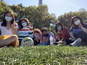Lucy & 4 friends on grass with masks