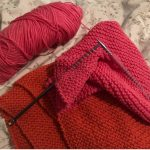 red blanket in process of being knitted